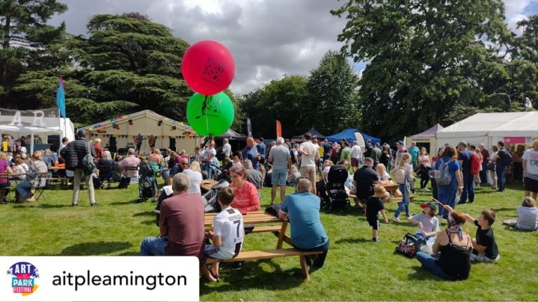 Image of stalls and people at Art in the Park 2021